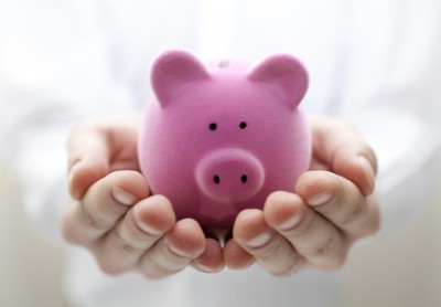 Man holding piggy bank. Shallow DOF