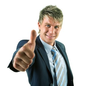 A businessman in a suit giving the thumbs-up sign (the thumb app