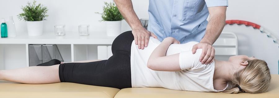 Chiropractic Examining Patient