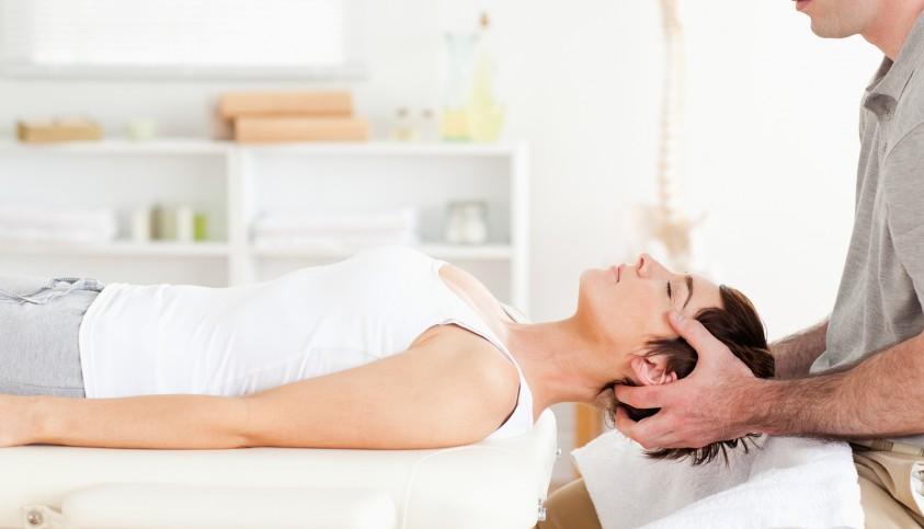 bigstock-chiropractor-stretching-a-cute-23236985-e1427894565757